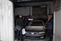 Expertise après sinistre d'une voiture dans un garage